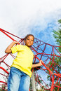 African boy holds and stands on red ropes Royalty Free Stock Photo