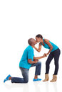 African boyfriend proposed american women kissing her after he isolated on white background Royalty Free Stock Images