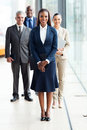 African business leader beautiful female with team standing on background Stock Image