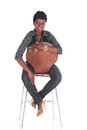African business woman sitting down female in casual uniform on a chair Stock Images