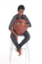 African business woman sitting down female in casual uniform on a chair Royalty Free Stock Photography