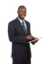 African Businessman Holding a Touch Pad Tablet PC Stock Photography