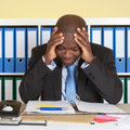 African businessman at office in crisis Royalty Free Stock Photo