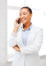 African businesswoman with smartphone in office business and communication concept smiling Stock Photo