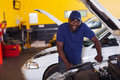 African car mechanic male inside workshop Royalty Free Stock Photo