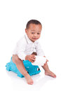 African child on potty play with toilet paper iso isolated over white Stock Photos