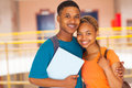 African college couple cheerful on campus Royalty Free Stock Photos