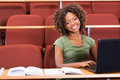 African college girl laptop happy using in class Royalty Free Stock Photography