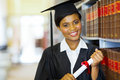 African college graduate pretty female in library Royalty Free Stock Images