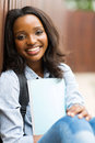 African college student outdoors happy female sitting Royalty Free Stock Images