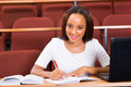 African college student portrait of young female studying in lecture hall Royalty Free Stock Photo