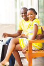 African couple bench young sitting on public after shopping Stock Photography