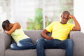 African couple conflict young having sitting on the sofa Stock Image