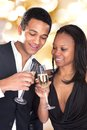 African couple enjoying champagne drink portrait of over grey background Stock Photos