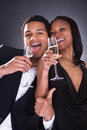 African Couple Enjoying Champagne Drink Royalty Free Stock Photo