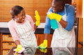 African couple household chores young having fun while doing Stock Images