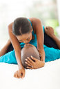 African couple kissing intimate in bedroom Royalty Free Stock Photo