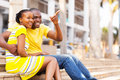 African couple outdoors happy american sitting in the city Royalty Free Stock Photography