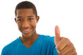 African descent teenage boy giving thumbs up ethnicity with sign isolated on white background Royalty Free Stock Photography