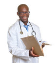 African doctor reading a medical record smiling male from south africa with patient in his hand on white background Royalty Free Stock Photos