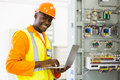 African electrical engineer using laptop successful checking machine status Stock Images