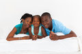 African family on bed Royalty Free Stock Image