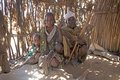 African family at the village of arbore ethnic group are sitting inside hut along road from turmi to weyto ethiopia Royalty Free Stock Image