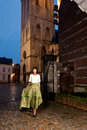 African fashion model in victorian dress old city the historic of leuven with medieval church and antique houses Royalty Free Stock Photos