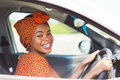 African female driver cheerful inside a car Royalty Free Stock Photo