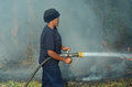 African female firefighters helped extinguish a bush veld fire allegedly started by shorting power lines in hilton pietermaritzbu Royalty Free Stock Photos