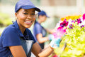 African female florist portrait of cute working in nursery Stock Photo