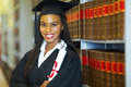 African female graduate beautiful in library on graduation day Stock Photo