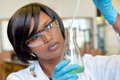 African female researcher with glass equipment in the lab soft focus on and hands Royalty Free Stock Image