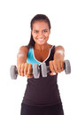 African fitness woman working out with free weights beautiful Royalty Free Stock Photo