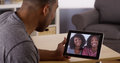 African friends video chatting on tablet black Royalty Free Stock Image