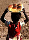 African girl with bread buns Royalty Free Stock Photos
