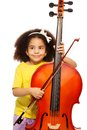 African girl holding violoncello and playing Royalty Free Stock Photo