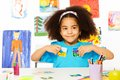 African girl plays developmental game, holds cards Royalty Free Stock Photo
