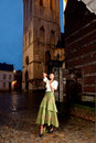 African girl in victorian dress in the city historic of leuven with medieval church and antique houses Stock Images