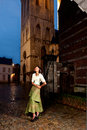 African girl in victorian dress old city the historic of leuven with medieval church and antique houses Stock Photos