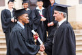 African graduate handshaking dean happy male with Royalty Free Stock Photo