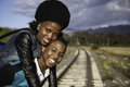 African guy and girl waiting for train on the tracks Stock Photography