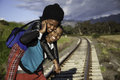 African guy and girl waiting for train on the tracks Royalty Free Stock Image