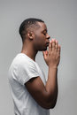 African guy praying God and asking for good things Royalty Free Stock Photo