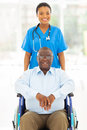 African health care pretty worker and disabled senior patient Royalty Free Stock Photos