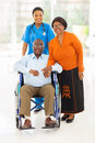 African healthcare worker senior couple portrait of female with at home Royalty Free Stock Photos