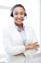 African helpline operator with headphones business communication and call center Royalty Free Stock Photos