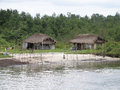 African hut in the tropics huts of local residents or aborigines along river bank warri nigeria tropical africa Stock Photos