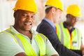 African industrial engineer smiling with colleagues Stock Photos