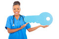 African intern key cheerful medical doctor holding a large toy Stock Images